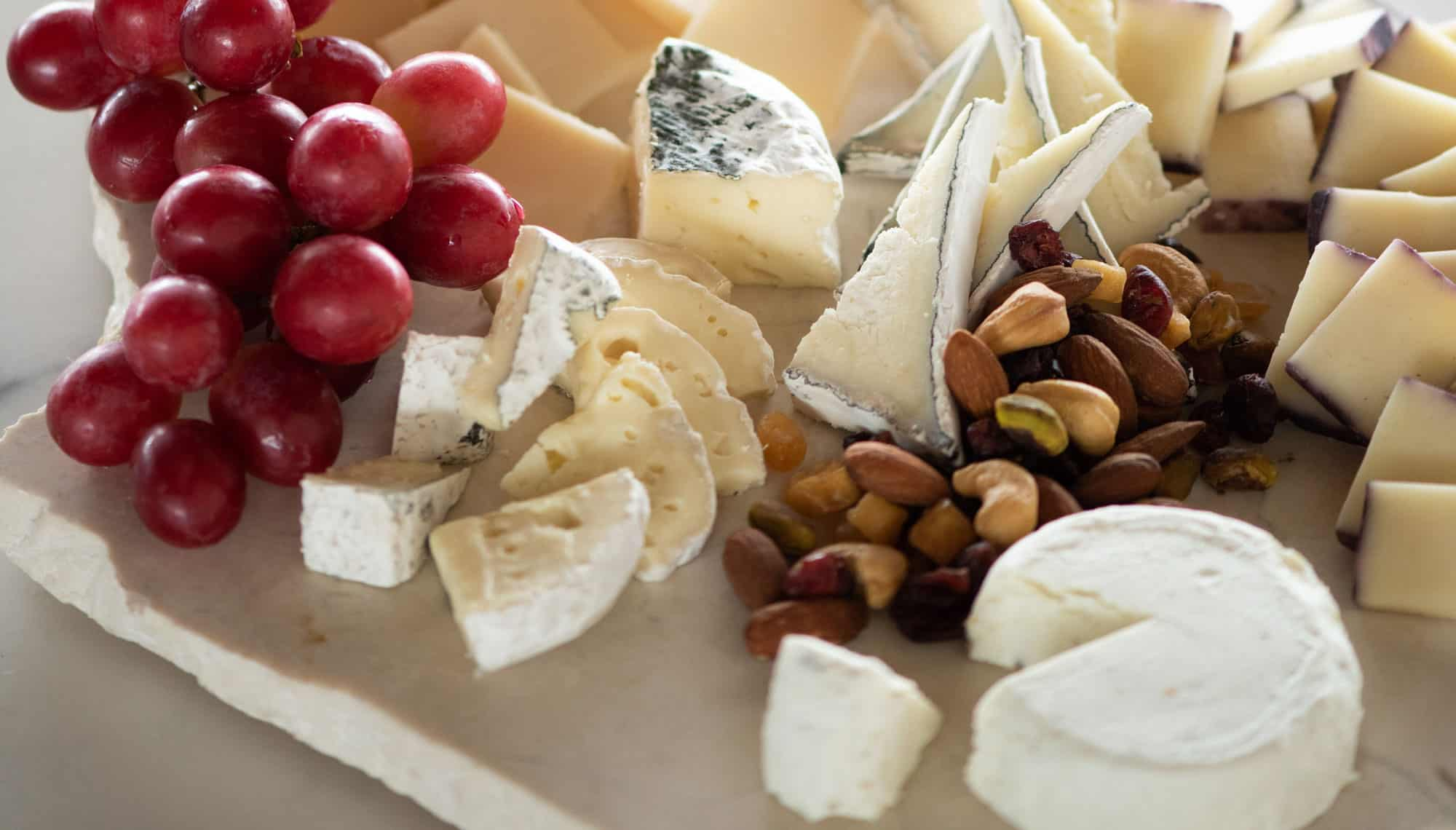 Cheese, nuts and grapes plate
